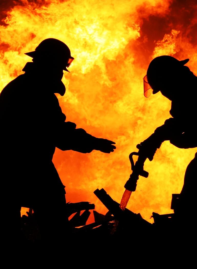 Firefighters battling a blazing fire