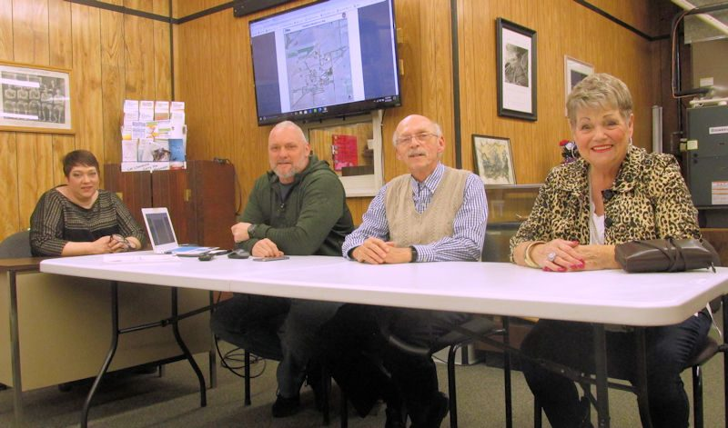 Town Council sitting at meeting table